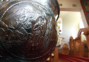 This image depicts the baptismal font used in St. Sava Serbian Orthodox Church, Merrillville, Indiana. Etched on one side is the scene commemorating Christ's baptism by John the Forerunner in the River Jordan, and the beginning of Christ's earthly ministry.